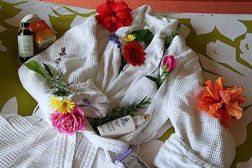Spa Bath Robe, lotions, and flowers
